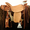 Half Breed Wade Saddle by Keith Valley   Specs: Wade tree by Rick Reed 16 inch seat Gullet - 7 & 1/2H by 6 & 1/4W by 4 94 Degree Bars Horn - 3 & 5/8ths high by 4 & 1/2 Guatelajara Cantle - 4&1/2 inches high by 12&1/2 inches wide Cheyenne Roll - 1 & 3/4 inches 7/8ths flat plate riggin, Vaquero Geometric Border with Sheridan Style Floral Stainless Steel Hardware - by Harwood 4&1/2 inch Monel Stirrups Santa Barbara twisted stirrup leathers Full length stirrup leathers 32 inch 100% Mohair Roper Cinch 7 foot latigos - both sides Ready to ride and go to work.