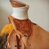 a working wade saddle, 3/8ths tooled with a classic medium Sheridan style flower.
