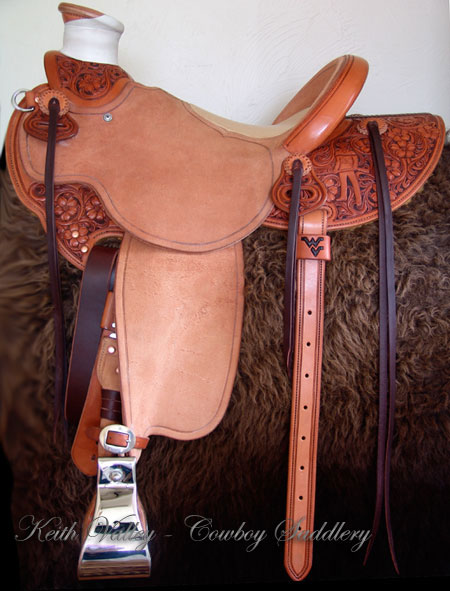 Cowgirl Cate light weight Wade with Orchid Floral tooling.  Contact us about a saddle made just for you like this one.