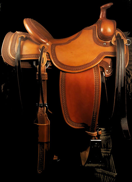 Will James tree, 16 inch seat, Gullet - 7 and 1/2 inch by 6 and 1/4 inch by 4 inch, Horn 2&1/2 inch Metal Dally, 92 degree bars, 7/8ths flat palte riggin, Cheyenne Roll, Full Vaquero Lace Border Saddle built by Keith Valley.