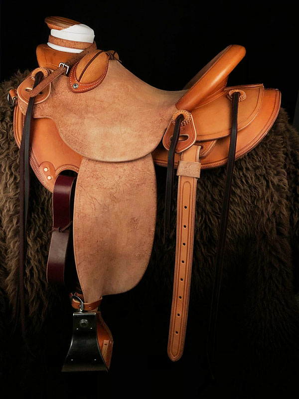 The Colt Starter, Wade Tree, 15 inch seat, Gullet - 7 and 1/2 inch by 6 and 1/4 inch by 4 inch, Horn 4 and 1/4 by 4 inch Guatelajara, 90 degree bars, 7/8ths flat palte riggin, Cheyenne Roll, built by Keith Valley.